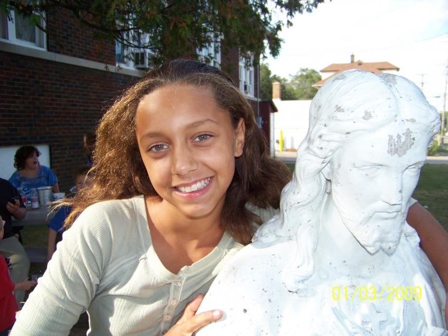 Girl with Jesus statue