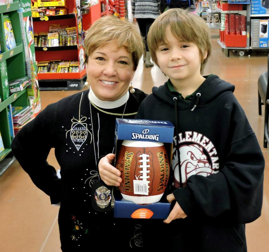 Pastor Jennifer helps with Buda PD's Blue Santa event