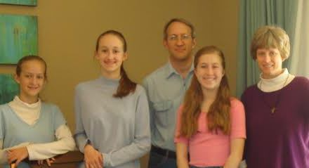 CINDY MELENRIC, WITH HUSBAND TOM AND DAUGHTERS BEKAH, HANNAH, AND SARAH